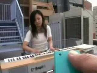 Young Mom Forced To Play Piano While Sitting On Strange Device