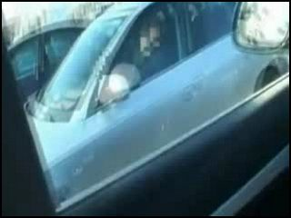 Good Looking Blonde Gives A Head To Her Man While He Is Driving Highway