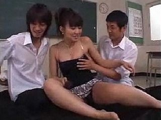 Japanese Student Hottie Faces Off Against Two Dicks At Once