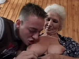 Granny Mom in Black Stockings is Fucked by a Young Guy