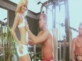 Blonde Beauty Gangbanged at the Gym by Two Strong Guys
