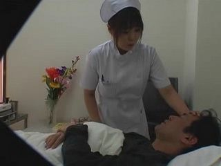 Japanese Nurse Putting Down Patients Temperature on her Way