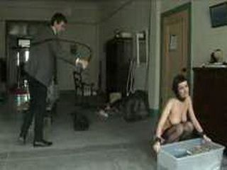 Brunette sorts magazines and flogged by master