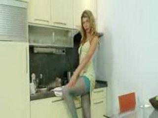 Blonde Vanesa masturbates through her blue nylons in kitchen