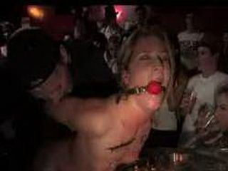 Gagged Ariel fucked with strap on toy in lesbian bar