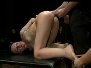 Bound brunette fucked and whipped by audience