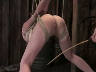 Tied and suspended babe fucked and caned