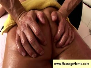 Gay masseuse spits on a cock