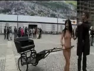 Naked babe pulling rickshaw in the streets