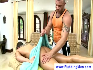 Tattooed masseuse grabs a guy dick