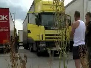 Brunette pussy and mouth fucked in the trucks parking