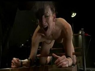 Strapped babe gets electro shocks in dungeon