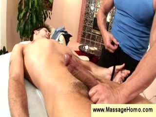 Masseuse puts a condom on