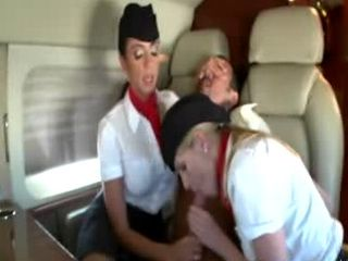Two flight attendents suck a guys cock