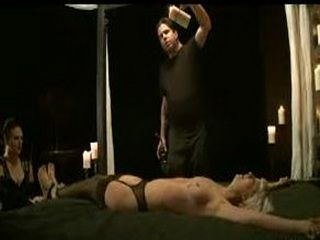 Bound blonde caned and waxed in bed