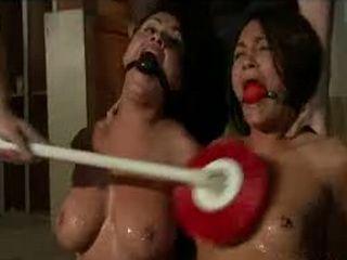 Cops washing gagged bare babes in garage