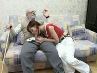 Teen Girl taking Care about Friends Grandpa
