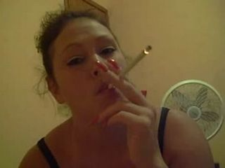 Sexy babe smoking cigarette and sucking cock