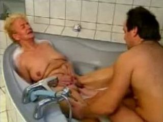 Oma in the bathroom with a younger guy