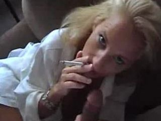 Smoking babe sucks cock and gets jizzed on