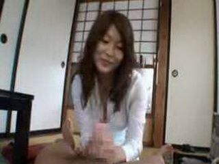 Japanese milf sex toy saleswomen gives you hands-on demonstration