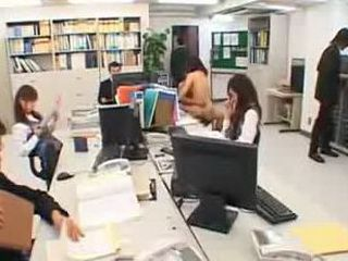 Japanese couple fucks in the middle of an office