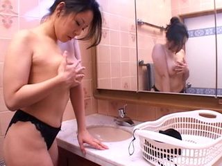 Japanese MILF Masturbates Her Pussy In Bathroom