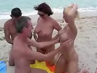 Blonde Milf Organize Orgy on the Beach