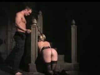 Busty bondage blonde gets spanking in a dark room