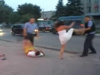 Furious  Chick Beating The Police Officers While Her Boyfriend Gets Knocked Out