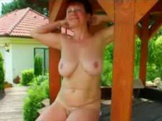 Granny does  it outdoors