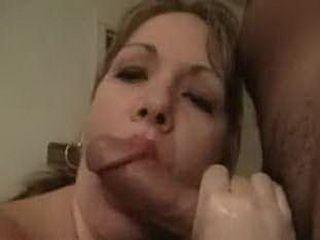 Busty brunette MILF sucks cock and balls