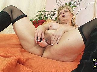 Old grandma moans like crazy when masturbates