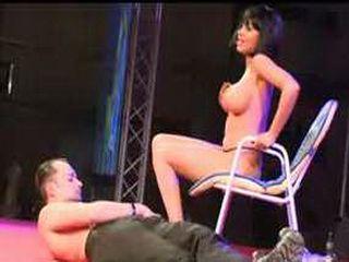 Stripper on stage teasing guy