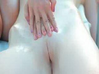 Teen lesbians massaging hot bodies at pool