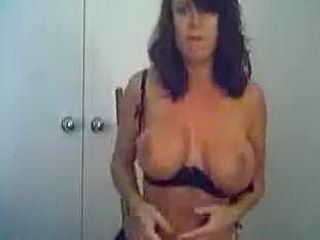 Busty MILF stripping and teasing on cam