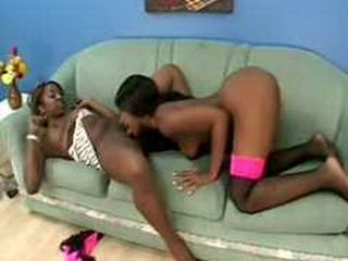Two horny ebony lesbian whores have fun with huge dildo