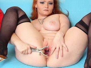 Redhead babe Samantha pussy gaping tool
