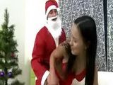 Stunning brunette teen and santa do it on the couch