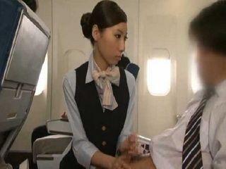 Japanese Stewardess Gives Tekoki Service To A Customer CFNM