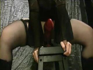 Girl Fucks Huge Red Dildo On the Chair
