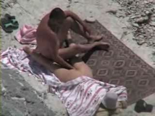 Husband And Wife Having Fun On The Beach