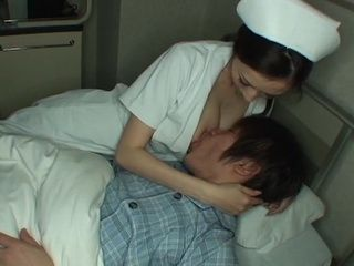 Attentive Nurse Julia Is Calming Down Boy Upset By Tomorrows Surgery