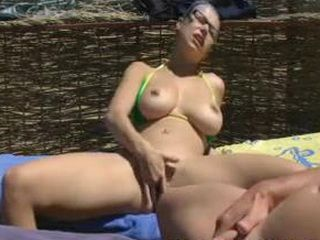 Big Titted Amateur Girl Fingering Her Pussy And Sucking Her Man In A Public Beach