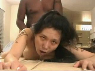 Busty Tattoed Asian Chick Gets Mercilessly Assfucked By Big Black Cock
