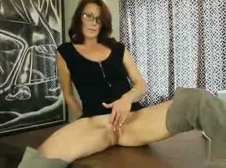 Mature With Glasses Fingering Her Pussy On Camera