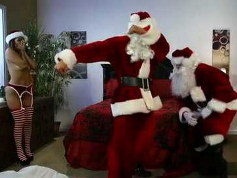 Two Santa Clauses Fight Over Naughty Santa Helper Pussy