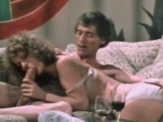 John Holmes big cock stud gives slut anal sex