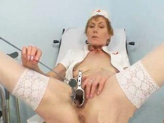 Mature Nurse Self Exam on Gynochair With Speculum