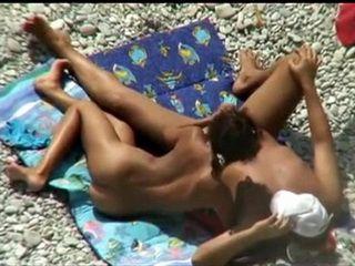 Voyeur Tapes Amateur Hottie Giving A Gentle Handjob On Public Beach
